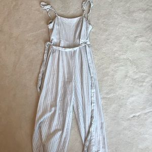 Cute white jumpsuit with black stripes!